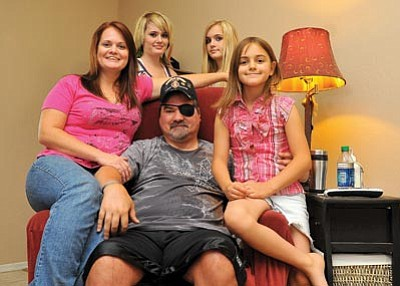 Matt Hinshaw/The Daily Courier<br> Iraq War veteran Alvin Burns sits with his wife Elizabeth and their three daughters at their home in Chino Valley. Buckup for Wounded Warriors is currently helping Burns, who was seriously injured in the war, coordinate the needed retrofits to make his home more accessible for him.