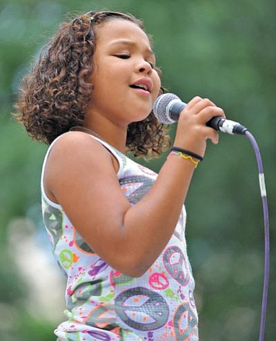 Matt Hinshaw/The Daily Courier<br>Kela Hedtke, 9, performs during Prescott's Karaoke Idol at the Courthouse Plaza Thursday evening.