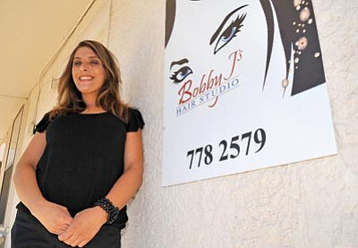 Matt Hinshaw/The Daily Courier<br>Jenny Colclasure opened Bobby J's Hair Studio in Prescott this past March.