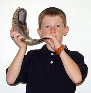 Courtesy photo<br> Zachary Askew, 10, of Prescott Valley will sound the shofar, or ram's horn trumpet, at High Holy Day services for Temple B'rith Shalom in Prescott.
