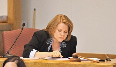 Matt Hinshaw/The  Daily Courier<br> Alexis Brown, a DNA expert from Sorenson Forensics in Salt Lake City, looks through her notes while being cross-examined by a defense attorney Thursday afternoon at the Yavapai County Courthouse.