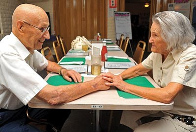 Matt Hinshaw/The Daily Courier<br> Holocaust survivor Esther Basch, 82, and Max Liebers, 92, U.S. Army Ret., sit and talk about each other's lives Friday evening at the Prescott Valley Elks Lodge. Liebers is one of the U.S. Army soldiers who liberated the concentration camp that Basch was in. They met for the first time last year in October.