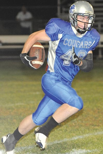 Brett Soldwedel/The Daily Courier<br /><br /><!-- 1upcrlf2 -->Chino Valley's Tanner Scott runs upfield against Phoenix South Pointe in Chino Valley on Friday.