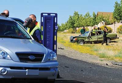 Les Stukenberg/The Daily Courier<br>First responders treat victims of a two-vehicle collision at the intersection of Granville Parkway South and Glassford Hill Road Tuesday afternoon. Emergency personel transported three people to Yavapai Regional Medical Center with what a police spokesman Sgt. Brandon Bonney said appeared to be non-life threatning injuries.