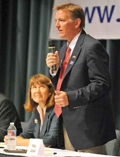 Matt Hinshaw/The Daily Courier<br>Republican candidate for the U.S. House of Representatives Paul Gosar answers a question while Democrat U.S. Representative Ann Kirkpatrick listens Saturday night at the Yavapai College Performance Hall during a Yavapai Tea Party candidates forum in Prescott.