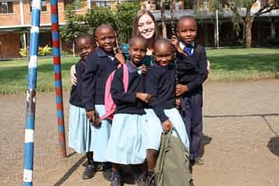 Courtesy photo<br>Prescott resident Angie Haggard gets in the swing of things with pupils at the School of St Jude in Arusha, Tanzania. Haggard is volunteering at the school for two years.