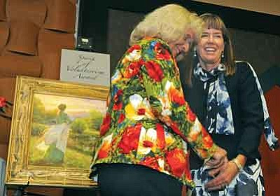 Courtesy photo<br>Barbara Polk receives AWEE's Spirit of Volunteerism award and a painting, presented by her daughter-in-law, Yavapai County Attorney Sheila Polk.