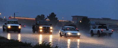 Les Stukenberg/The Daily Courier<br> Drivers make their way through a heavy downpour on Highway 69 that hit the Prescott/Prescott Valley area around 4:30 Monday afternoon. The storm hit suddenly and turned the blue sky into almost a night-time black sky.