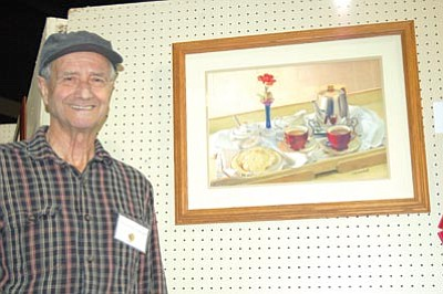 "Doug Cook/The Daily Courier<br> Prescott Valley artist John Eckstadt won Best in Show during the PV Art Guild's exhibit Saturday at the Fall for the Arts Festival for his painting ""Tea for Two."""