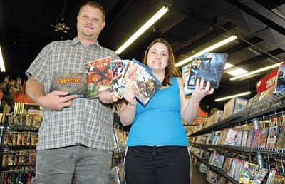 Brett Soldwedel/The Daily Courier<br> Jason and Amy McDonald, owners of Ignited Entertainment in Prescott Valley, opened up Sept. 3. They provide a variety of entertainment including movies for rental and purchase, comic books, card games and a gaming lounge in the back of the store.