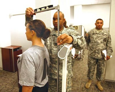U.S. Army/Courtesy<br>Sgt. Sherri Jo Gallagher gets her height taken at Fort Lee, Va., prior to taking part in the Best Warrior Competition, which consists of soldiers from all major commands battling with the best of the best in events that define the U.S. Army soldier.