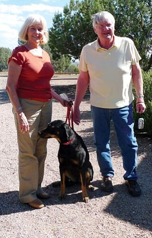 """Courtesy photo<br> This is Xena and her new owners, the Nelsons. Xena was scheduled to be euthanized but was re-evaluated under the new YHS """"No-Kill Ethic,"""" and received specialized behavior training at YHS. Xena is now happy at home!"""