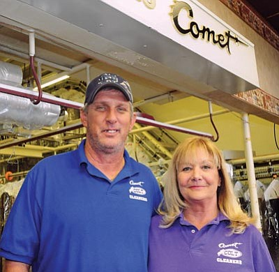 Brett Soldwedel/The Daily Courier<br> Wesley and Cindy Renee Winfree pose in Comet Cleaners.