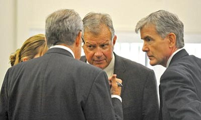 Matt Hinshaw/The Daily Courier<br> Steven DeMocker confers with his outgoing lawyers, John Sears, Larry Hammond and Anne Chapman, Friday afternoon at the Yavapai County Courthouse in Prescott.