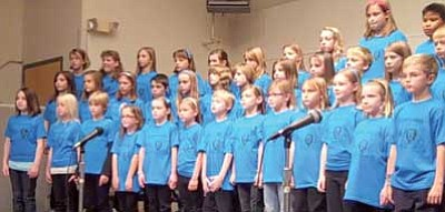 Video image/Paula Rhoden/The Daily Courier<br> Third-, fourth- and fifth-grade members of the Lincoln Elementary School choir practice during one of their recent classes. So many students turned out for the choir that the school's music teacher had to split the group into two.