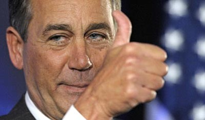 Cliff Owen/The Associated Press<br> House Republican leader John Boehner of Ohio celebrates the GOP's victory that changes the balance of power in Congress in Washington Tuesday.