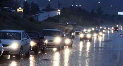Les Stukenberg/The Daily Courier<br>Drivers make their way through an Oct. 4 heavy rainfall on Highway 69 that hit the Prescott/Prescott Valley area around 4:30 that afternoon.  The storm hit suddenly and turned the blue sky into almost a night time black sky.