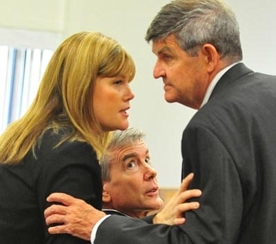 Les Stukenberg/The Daily Courier<br> Murder defendant Steven DeMocker looks on as his outgoing defense lawyers Anna Chapman and Larry Hammond confer during a hearing at the Yavapai County Courthouse on Friday.