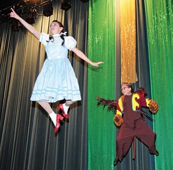 """Brett Soldwedel/The Daily Courier<br /><br /><!-- 1upcrlf2 -->Lexi Shepherd, 14, plays Dorothy in """"The Wizard of Oz"""" and flies around the stage with Liz Aranda, 11, during dress rehearsal on Tuesday. <br /><br /><!-- 1upcrlf2 -->"""