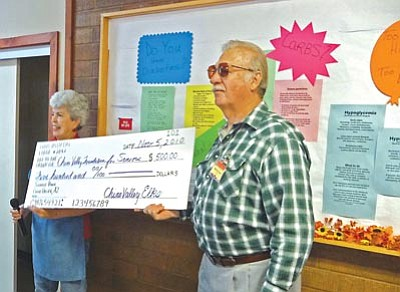 Courtesy photo<br>Elks Past Exalted Ruler Beverly Swanty presents a check to Chino Valley Foundation for Seniors Chairman Harvey Jones.