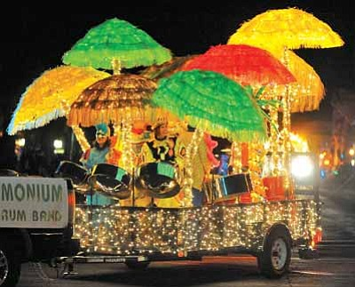 Matt Hinshaw/The Daily Courier file<br>The Pandemonium Steel Drum Band float makes its way down Cortez Street during last year's annual Holiday Lights Parade in downtown Prescott.