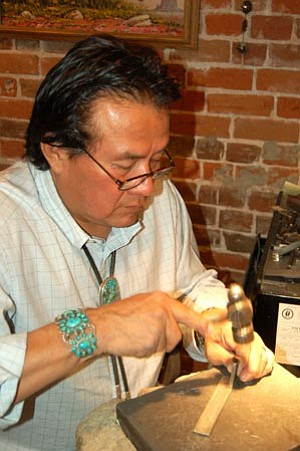 Jason Soifer/The Daily Courier<br> Ernie Lister, owner of the Hotel Trading Post in downtown Prescott, works on some jewelry Wednesday morning.