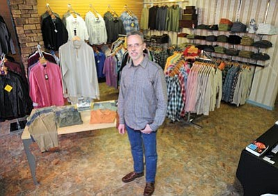 Brett Soldwedel/The Daily Courier<br> Ray Sola, owner of  Man at Leisure in the  Old Firehouse Plaza, poses in his new store on Tuesday.