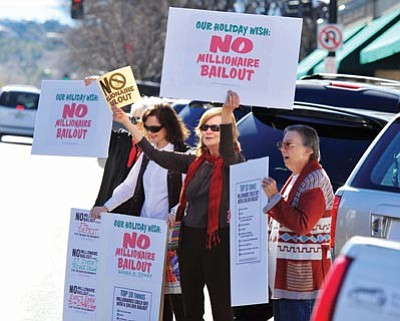 Les Stukenberg/The Daily Courier<br> MoveOn members gather outside of John McCain's Prescott office to protest his support of the Bush-era millionaire tax cuts.