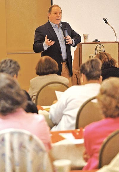 "Matt Hinshaw/The Daily Courier<br>Dr. Daniel Burchfield, an orthopedic surgeon, talks about arthritis in the shoulder during the Arthritis Foundation's ""Living Well with Arthritis Expo"" Friday afternoon at the Hassayampa Inn in Prescott."