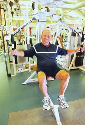Les Stukenberg/The Daily Courier<br>Al Dattola, a physical education teacher at Prescott High School who coaches athletes for the Special Olympics, uses a variety of workouts featuring weight training, walking and aerobic training to keep in shape.