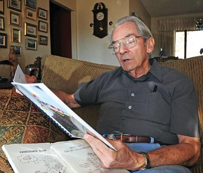 Brett Soldwedel/The Daily Courier<br>David Byrn recites his poetry in his home Tuesday. Byrn has written several poetry books that have been published, and he won several awards in the 2010 Arizona State Poetry Society's National Poetry Contest.