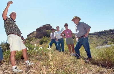 Nathaniel Kastelic/The Daily Courier, file photo<br> Greg Kornrumph, left, senior analyst of Water Rights and Contracts with SRP, leads a hike for the Big Chino Ranch mitigation group in September 2005 along the Verde River near Stillman Lake  in Chino Valley.