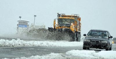Les Stukenberg/The Daily Courier, file photo<br> An ADOT snowplow clears Highway 69 as rain mixed with overnight snow in Prescott Valley on Jan. 21.