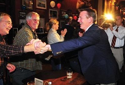 Les Stukenberg/The Daily Courier, file photo<br> Then-candidate Paul Gosar greets supporters at The Palace in downtown Prescott Nov. 2 after initial results showed him leading incumbent Ann Kirkpatrick in the race for the District One seat in the U.S. House of Representatives.