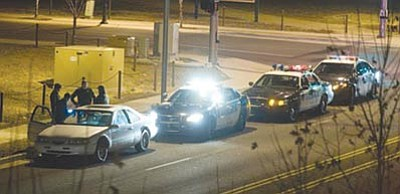 Les Stukenberg/The Daily Courier<br>Prescott Valley police stop and question a motorist suspected of driving under the influence in Prescott Valley during last year's holiday statewide enforcement effort. The suspect was taken into custody and the vehicle towed.