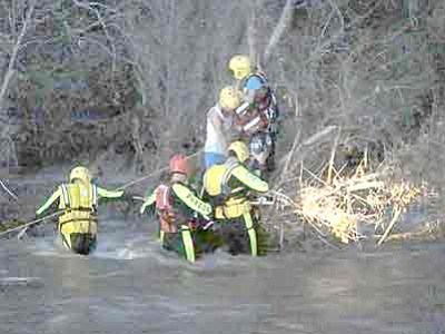 Yavapai County Sheriff's Office/Courtesy<br>Firefighters rescue two teenage boys from swift water in Beaver Creek this past Thursday.
