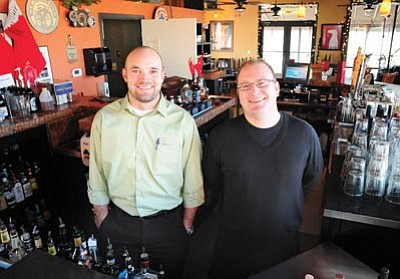 Brett Soldwedel/The Daily Courier<br> Aaron Meisheid, left, and Matt Anderson, owners of The Firehouse Kitchen in downtown Prescott, just celebrated the one-year anniversary of taking over the restaurant.
