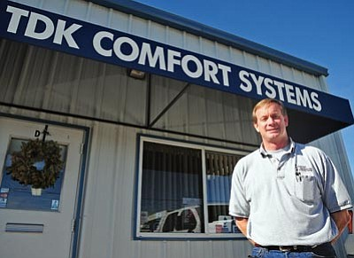 Brett Soldwedel/The Daily Courier<br>Troy Koski, owner of TDK Comfort Systems, an HVAC contractor, poses in front of his Chino Valley office on Tuesday.