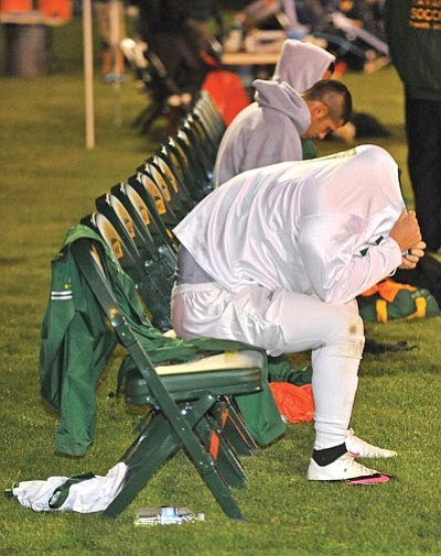 The Daily Courier<br /><br /><!-- 1upcrlf2 -->A Yavapai College soccer player hides his head after the Roughriders were eliminated from the NJCAA Region I, Division I playoffs in late October.