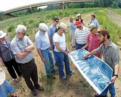 Matt Hinshaw/The Daily Courier<br>Prescott Creeks Preservation Association Executive Director Michael Byrd shows commissioners and staff from the Arizona Water Protection Fund, among others, an updated aerial map of the Watson Woods Restoration project during this July 2009 effort.