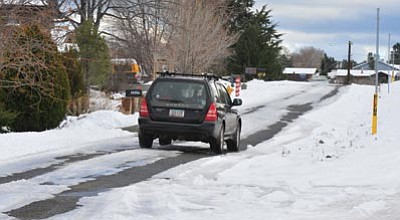 Les Stukenberg/The Daily Courier<br>Most major streets in Prescott have been cleared of last week's snow, although some of the residential streets – like Frisco Peaks Drive – hadn't seen the plow as of Monday afternoon.
