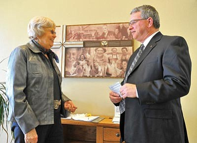 Matt Hinshaw/The Daily Courier<br> Good Samaritan Society's outgoing executive director Paula Kneisl gives some last-minute advice to Allan Tramel, the new executive director, Wednesday afternoon before Tramel's installation ceremony at the Prescott Village Senior Living Center.