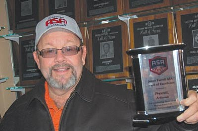 Ken Hedler/The Daily Courier<br>Don Fishel, Prescott's recreation supervisor and Arizona state commissioner for the Amateur Softball Association of America, displays the James Farrell ASA Award of Excellence in 2010 for hosting three national tournaments.