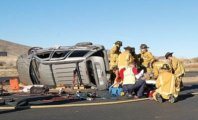 Firefighters with the Central Yavapai Fire District removed a passenger trapped inside a Jeep after it rolled onto its side on Glassford Hill Road Monday morning. This was the third vehicle rollover in the tri-city area since Sunday afternoon.<br /><br /><!-- 1upcrlf2 --><br /><br /><!-- 1upcrlf2 -->Jason Soifer/The Daily Courier