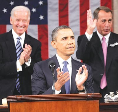 Pablo Martinez Monsivais/The Associated Press<br> President Barack Obama is applauded by Vice President Joe Biden and House Speaker John Boehner of Ohio prior to delivering his State of the Union address on Capitol Hill in Washington Tuesday.