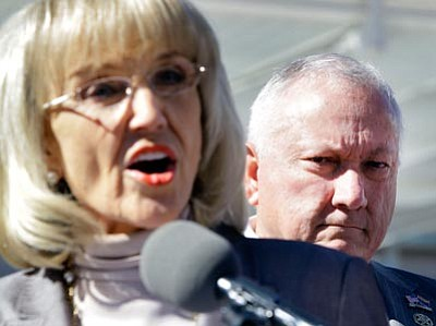 The Associated Press/Matt York<br> Arizona Gov. Jan Brewer announces plans Thursday outside the Sandra Day O'Connor Federal Courthouse in Phoenix to counter sue the federal government for failing to enforce immigration laws. Listening at rear is Arizona State Sen. Russell Pearce, R-Mesa.
