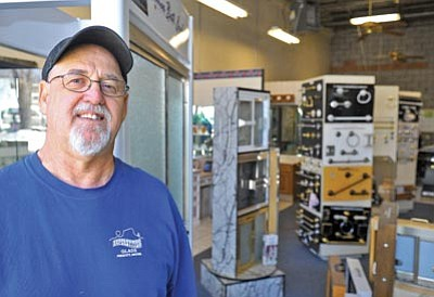 Matt Hinshaw/The Daily Courier<br> Kenny Olson, owner of Superstition Glass in Prescott, has been in business for the past 25 years.  Superstition specializes in custom shower doors, mirrors and glass.