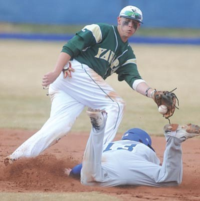 Photos by Les Stukenberg/The Daily Courier<br /><br /><!-- 1upcrlf2 -->TOP: Yavapai College's Ashton McCoy, left, prepares to tag a Salt Lake City Community College player at Chino Valley High School on Thursday. BELOW: YC's Robbie Ingram delivers to the plate versus Salt Lake City CC.