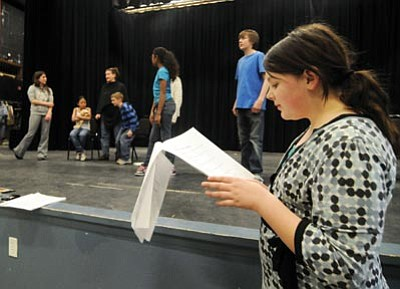 "Les Stukenberg/The Daily Courier<br>Young playwright Tiffany Whittemore follows along as the actors go through a rehearsal of her play ""The Promise of an Orphan"" at Franklin Phonetic School in Prescott Valley Tuesday evening."