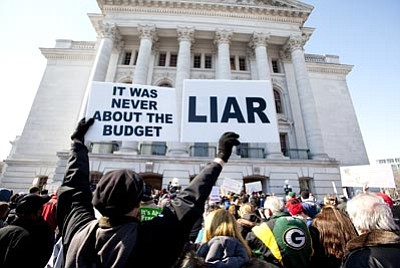 Steve Apps/Wisconsin State Journal, AP<br> Protests continue in Madison, Wis., after the Senate passed governor's controversial budget repair bill Thursday.